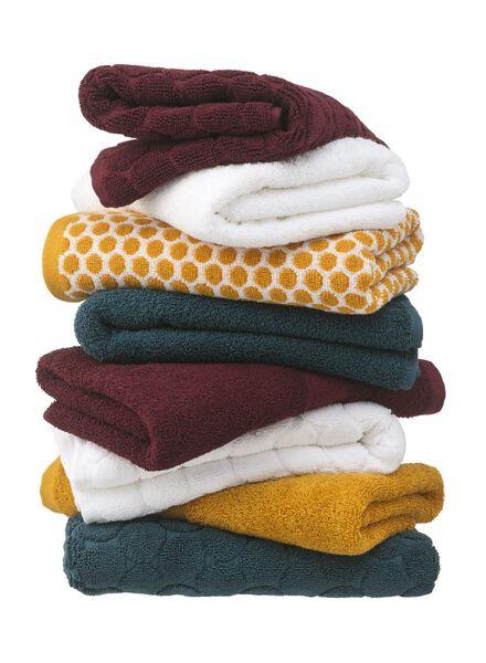 handdoek - 50 x 100 - zware kwaliteit - okergeel gestipt - 5220026 - HEMA